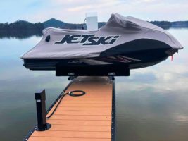 jet ski on lake pier rechargin with outdoor PEDOC Power pedestal